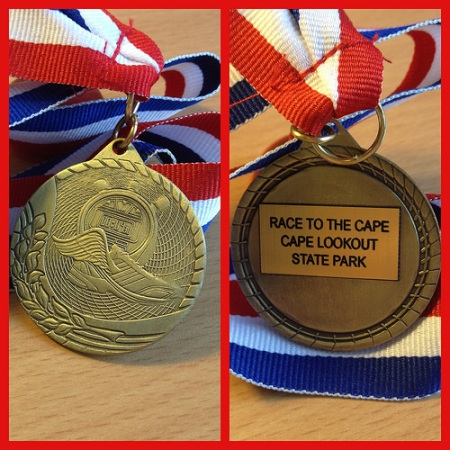 Front and back of my hard earned medal.